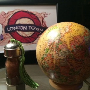 Sand from the Sahara Desert and a print from London with a globe